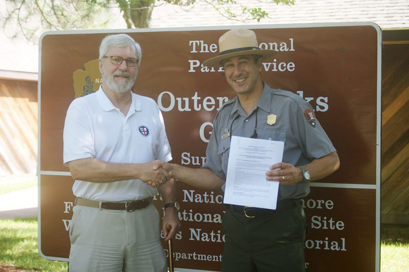 First Colony's Eric Klingelhofer and National Park Service's Dave Hallac look to continuing research at Fort Raleigh National Historic Site